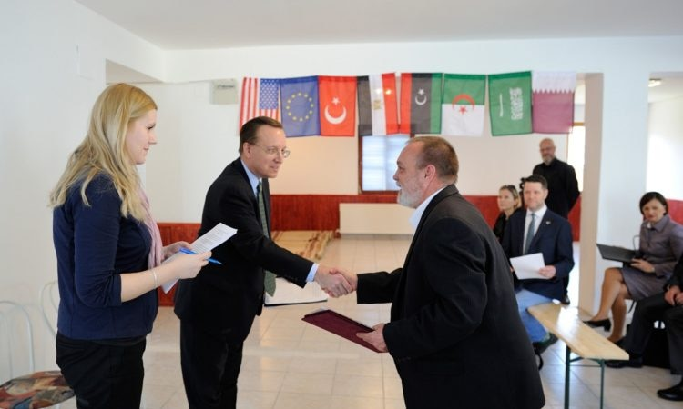 Chargé David Kostelancik shaking hands with the leader of Gyula Germanus Islamic Cultural Center