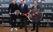 three men standing with tennis rackets